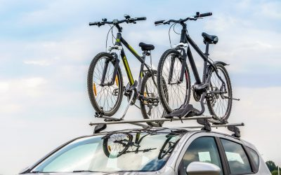 car with roof rack holding bikes